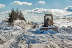 Truck cleaning road in winter Royalty Free Stock Photo