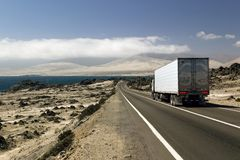 Truck at a coastal highway Stock Photos