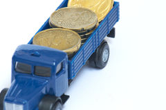 Truck with coins Royalty Free Stock Photography