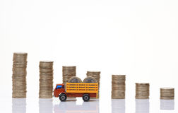 Truck with coins. Pile of coins with toy truck loaded with coins Stock Photography