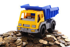 Truck with coins Stock Photos