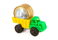 A truck with coins. A small truck carrying euro coins Stock Photos
