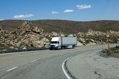 Truck Coming Downhill On Four Lane Highway Royalty Free Stock Image