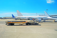 Truck by commercial airplanes. Fuel truck by commercial airplanes Royalty Free Stock Image