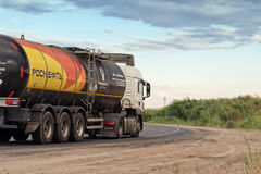 Truck company ROSNEFT hauling a fuel tanker. VOLGOGRAD - JULY 30: Truck company ROSNEFT hauling a fuel tanker along the asphalt road out of town. July 22, 2016 Stock Images