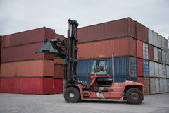 Truck and container. Forklift and containers yard in thailand stock image