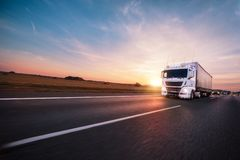 Truck with container on road, cargo transportation concept. Royalty Free Stock Photo