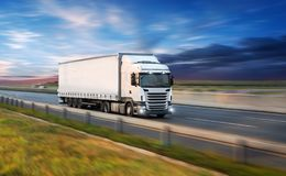 Truck with container on road, cargo transportation concept. stock images
