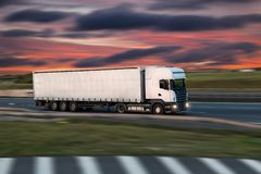 Truck with container on road, cargo transportation concept. Truck with container on highway, cargo transportation concept. Shaving effect stock images