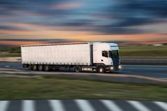 Truck with container on road, cargo transportation concept. stock photography