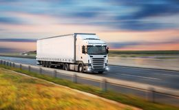 Truck with container on road, cargo transportation concept. royalty free stock photos