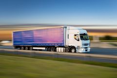 Truck with container on road, cargo transportation concept. stock photos