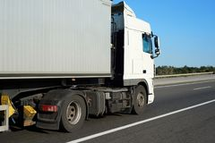 Truck with container on the road, side view with clear blank space Royalty Free Stock Photography