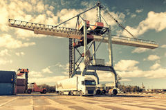 Truck container truck and crane in the port Royalty Free Stock Photos