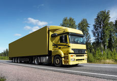Truck on country road. Yellow truck on country highway Stock Photography