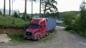 Truck is at a country road. Beside the forest stock video footage