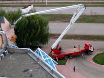 Truck crane. Big lifting tap assembles billboard stock photo