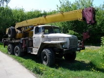 Truck with crane. Truck with yellow crane at the grebe field near road Royalty Free Stock Photos