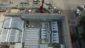 Truck Crane Aerial Drone Footage. Huge truck crane lifting a cooling tower aerial view stock footage