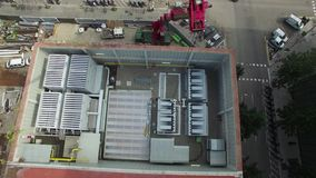 Truck Crane Arm Aerial Drone View. Huge truck crane lifting a cooling tower aerial view stock video footage