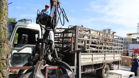 Truck crane carry steel scrap in factory. Scrap yard area for move to recycle in Thailand stock footage