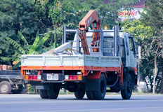 Truck with crane. CHIANGMAI, THAILAND - DECEMBER  8 2014: Private Truck with crane.  Photo at road no.121 about 8 km from downtown Chiangmai, thailand Stock Photo