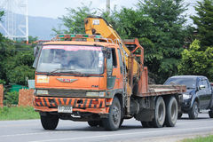 Truck with crane of Doisaket Concrete. CHIANGMAI, THAILAND -AUGUST 9 2016:  Truck with crane of Doisaket Concrete.    On road no.1001, 8 km from Chiangmai Royalty Free Stock Images