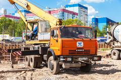 Truck crane KAMAZ working at the construction  site under constr Stock Images