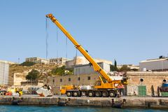 Truck crane in Shipyards harbor of Malta. In clear weather on a background of blue sky Royalty Free Stock Photos