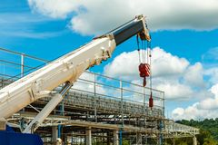Truck and Crane in site for construction and blue sky Stock Photography