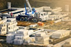 Truck crane standing on a construction site royalty free stock images