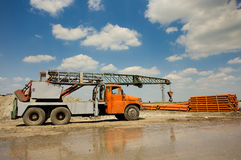 Truck with crane working at construction site Royalty Free Stock Photos
