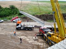 Truck and creane lifting up beam stock photography