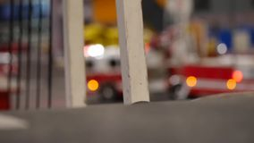 Truck crossing the bridge, close up, fire truck in the background - unfocused style of the camera. Truck crossing the bridge, close up, fire truck in the stock footage