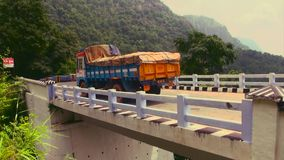 Truck crossing the bridge. Nature background stock video footage