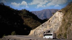 Truck Crossing Mountainous Valley. Truck Crossing a Mountainous Valley high speed stock video footage
