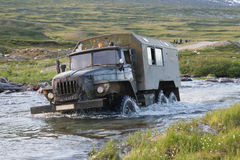 Truck crossing a river stock images