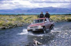 Truck crossing river near El Calafate, Patagonia, Argentina Stock Photo