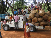 A truck crowded with people and baskets Stock Photography