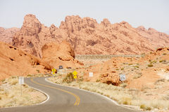 Truck on Curving Road Through Desert Stock Photography