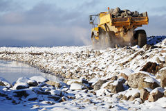 Truck delivering rocks for dredging Stock Images