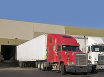 Truck delivering to warehouse Stock Photos
