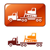 Truck delivers the bulldozer. Vector icon Stock Photos
