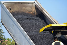 Truck delivers new asphalt material Stock Photo
