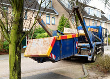 Truck delivers waste container stock image