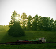 Truck delivery with sun and trees Royalty Free Stock Image