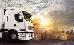 Truck in a deposit with packages ready to start. To deliver royalty free stock image