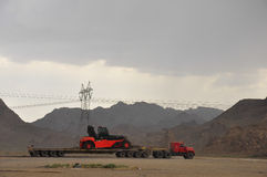 TRUCK IN DESERT. A TRUCK IN THE IRANIAN DESERT ON THE ROAD BETWEEN BANDAR ABBAS AND KERMAN IN IRAN Stock Photos