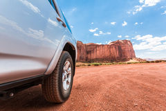 Truck in desert with mountains on the background. Royalty Free Stock Photo