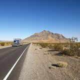 Truck on desert road. Stock Photo